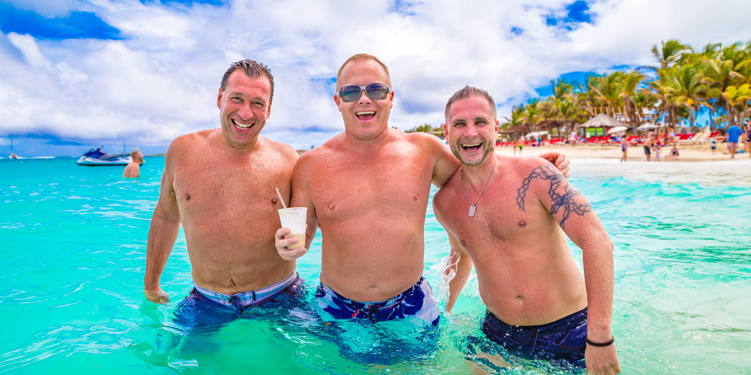 three men having fun laughing in the ocean