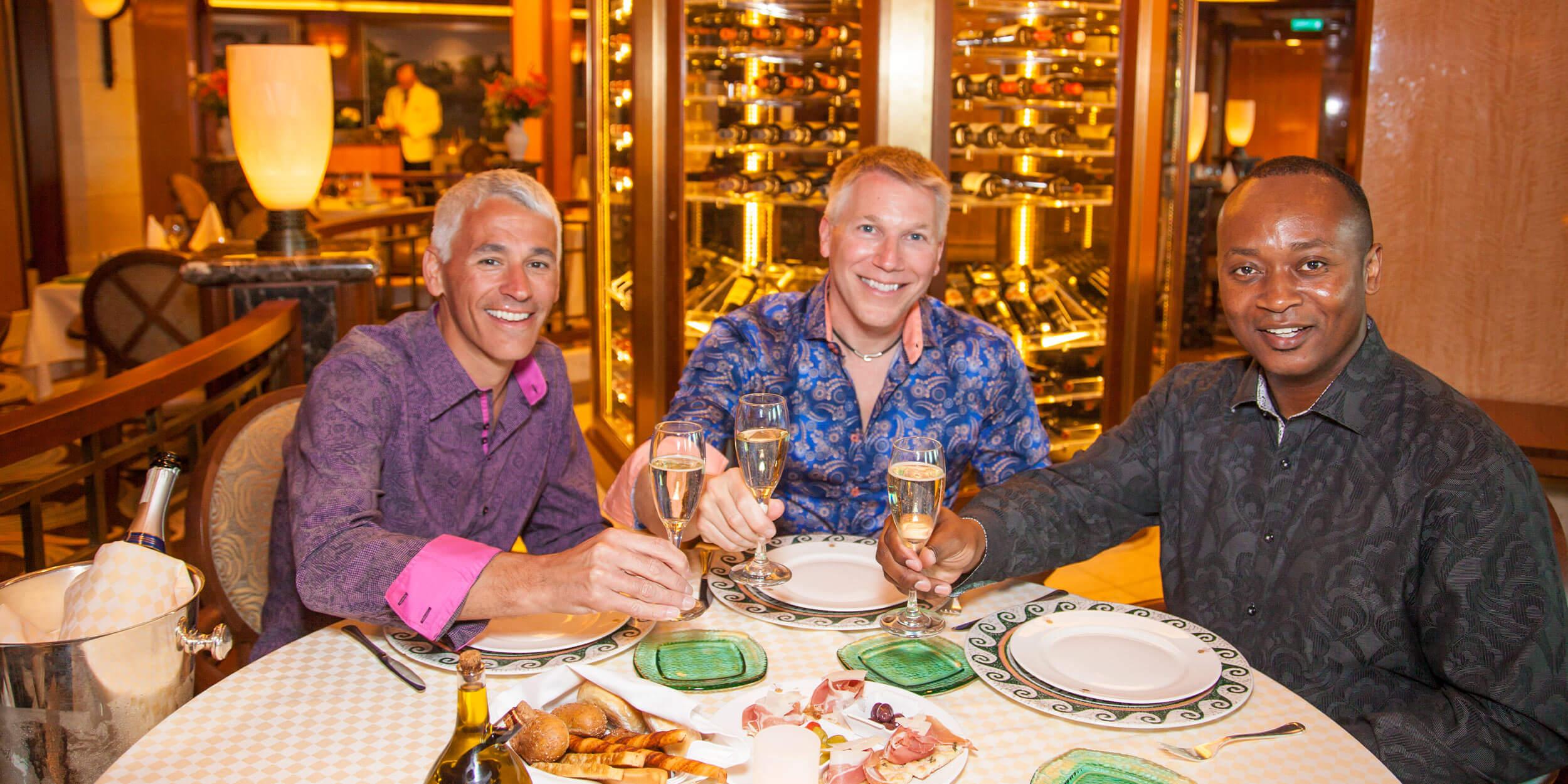Three men dining and toasting wine